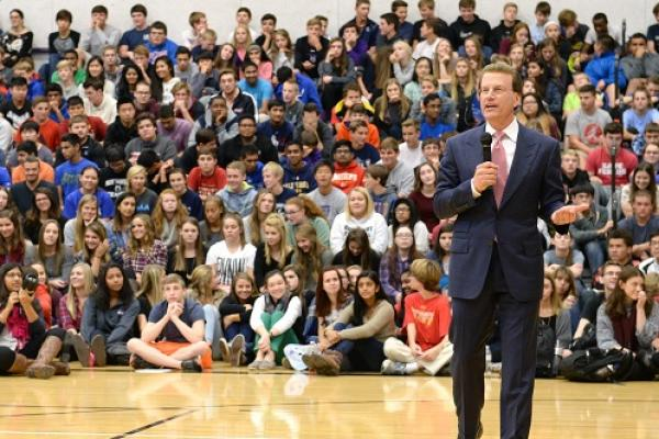 Lowell Milken addresses Blue Valley NW HS smithymanCROP