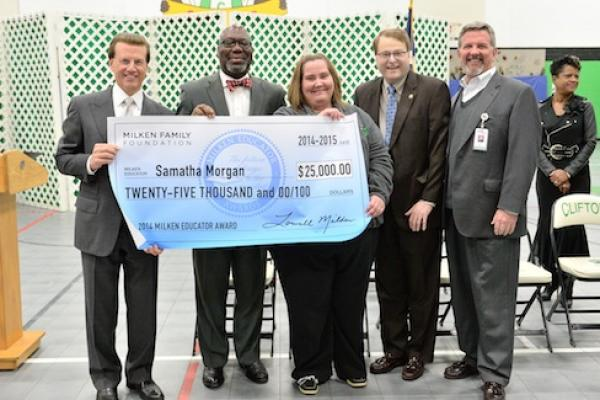 Samatha Morgan Lowell Milken and VIPs with check