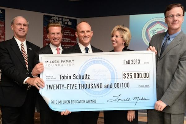 Tobin Schultz group shot with Lowell Milken